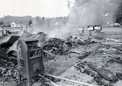 Not much remains of the Petrolia post office, foreground, and general store after  it was razed by the April 25, 1992, quake that was centered about five miles away. (Times-Standard file photo)