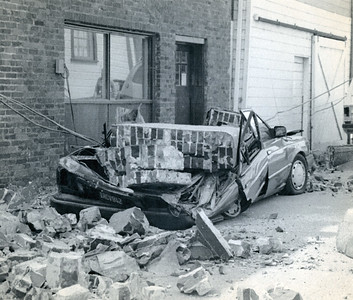 Multiple vehicles were crushed by falling debris in the April 25, 1992 quake. (Photo by The Associated Press)