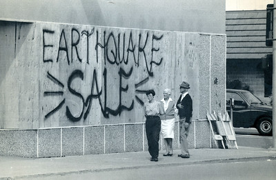A Fortuna business advertises an earthquake sale on boards covering broken windows. (Photo by The Associated Press)