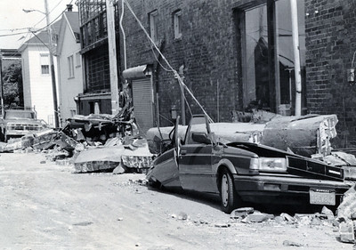 The Cape Mendocino quake caused nearly $70 million in damages along the North Coast. Cars like this one in Ferndale were crushed by falling debris. (Photo by The Associated Press)