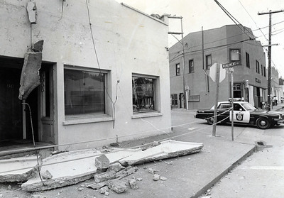 A police car rolls past a Rio Dell business that was impacted by the Cape Mendocino quakes. (Times-Standard file photo)