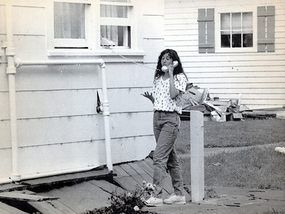 April Santiago, then 16, chats on the phone after the Cape Mendocino quakes made her home uninhabitable in Ferndale. While the home was destroyed, the phone still worked. (Times-Standard file photo)