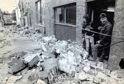 Diane and Dan Smidt look at the scene at the Valley Grocery in Ferndale. Rubble from the Cape Mendocino earthquake that struck at 11:06 a.m. on April 25, 1992, litters the alley. (Times-Standard file photo)