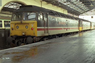 The following morning I awoke to find that 47675 'Confederation of British Industry' had piloted 47673 'Galloway Princess' forward from Perth on 1S25 2115 ex-Euston. The pair are pictured on arrival at Inverness (04/01/1992)