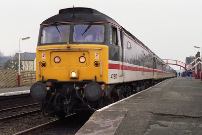 47815 pauses at Appleby with 1S41 1037 Manchester Piccadilly-Edinburgh, which was today diverted via the 'Settle & Carlisle' because of weekend engineering work on the WCML (28/03/1993)
