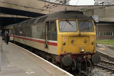 Having had its 'Glorious Devon' nameplates removed for its new life as a humble 'ballast' loco, 47824 is pictured on arrival at Birmingham New Street before running round 1O13 1205 York-Poole (26/04/1993)