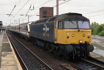 47473 calls at Wigan North Western with an unidentified Euston-Glasgow service. Engineering work on the WCML over the Bank Holiday weekend meant that trains were either being diverted via Manchester, or, as with this one, diesel-hauled between Edge Hill and Preston (31/05/1993)