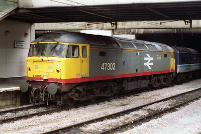One of the few examples still carrying the short-lived 'red-stripe' Railfreight livery, 47302 'Meridian' is pictured on arrival at Birmingham New Street with 1M93 1014 from Great Yarmouth (21/08/1993)