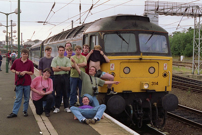 After parforming an 'induction ceremony' on thier latest recruit, some of the 'o'-gang pose alongside '314 at Norwich (07/08/1993)