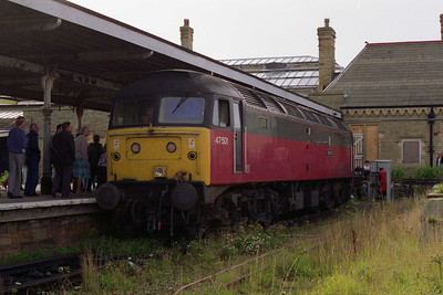 An hour or so later 47501 negotiates the undergrowth at Morecambe Promenade station as it runs round on arrival (15/08/1993)