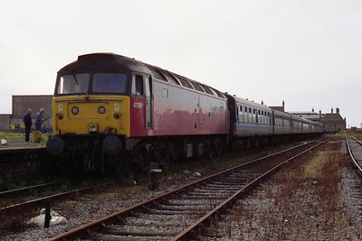 Morecambe Promenade station was due for closure and redevelopment soon after this train ran. A new structure more suited to 2-car DMUs was opened approximately 1/4 mile up the line towards Lancaster, and a car park occupies the spot where 47501 and its train stood in this scene (15/08/1993)