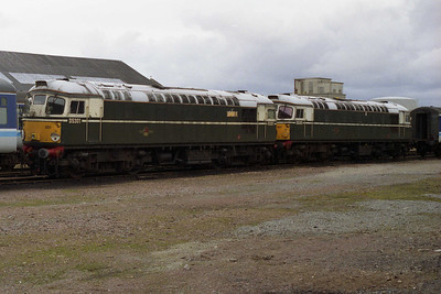 26001 (left) and 26007 had been repainted green for their final year in traffic, and had been semi-regular performers on a dated summer loco-hauled diagram to Kyle. Now also withdrawn from service, both loco's ultimately found a future in preservation (19/03/1994)