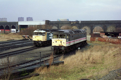 47448 (left) and 47515 are viewed from a passing charter train in the yard at Holbeck (05/02/1994)
