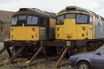 /26004 and 26032 stand side by side in the sidings at Inverness TMD. The former survives in preservation at Bo'ness (19/03/1994)