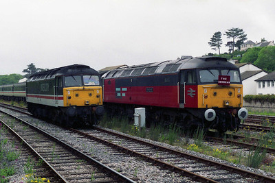 Whilst running round its train in Goodrington Carriage sidings, 47807 passes 47777 'Restored' with the empty stock for the 1723 return MCRUA charter to Manchester (27/05/1995)