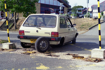 A lesson in why not to drive your car the wrong way over collapsible plates in the road!! This scene greeted us at the entrance to the station car park at Oxford when arriving for '1M48' one Sunday morning (27/08/1995)