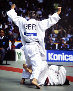 1993 Hamilton World Judo Championships 931002A7106: of Great Britain (white belt)  celebrates defeating Olympic bronze medallist, Chiyori Tateno of Jap....