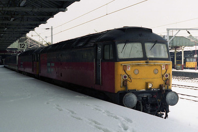 47701 + 47627 are pictured in a snow-covered Platform 12 at Crewe station after arriving with 1A29 0906 Holyhead - Euston. '627 had been failed after arrival with 1D88 the previous night and '701 had been sent out in the consist of the last train from Crewe to recover it (27/01/1996)