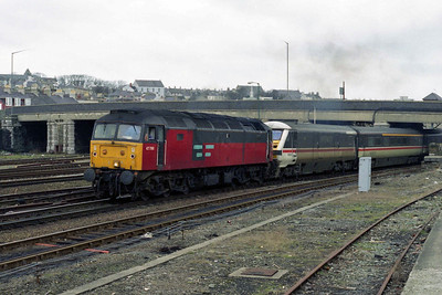 47780 is seen shunting the empty stock off 1D86 from Platform 3 across to the sidings at Holyhead. Note the Mk3 'BFO' coach adjacent to the 'DVT' (11/02/1996)