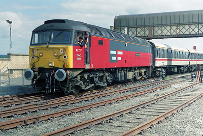 Running round a 12-coach train at Stranraer was a tricky manouevre: having pushed the stock back into the platform 47757 had to draw forward again with the points set into the middle road to leave sufficient clearance at the north end of the station (18/05/1996)