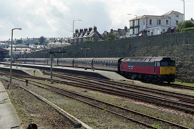 A view from the sea wall of 47761 waiting to depart from Penzance with the 1602 return leg to Birmingham New Street (11/05/1996)