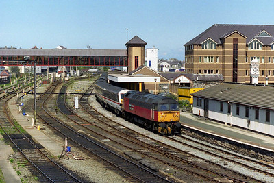 Deputising for an unavailable HST, EWS' 47767 waits to depart from Holyhead with 1A55 1338 to London Euston, which it would work as far as Crewe (04/05/1996)