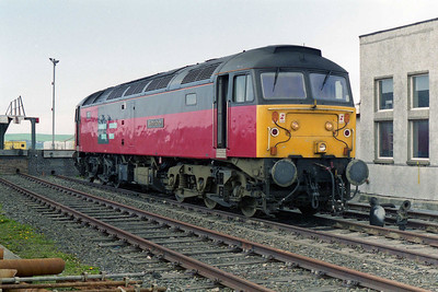 The end of the line. 47757 looks out over the Irish Sea whilst running round its train at Stranraer Harbour (18/05/1996)