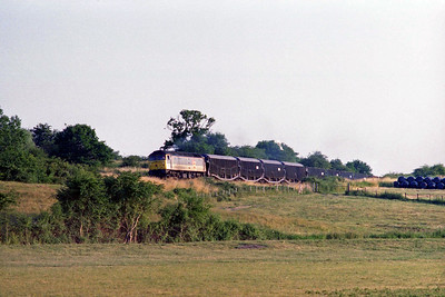 An unidentified RfD '47' heads north through Somerton with an empty car train (22/07/1996)