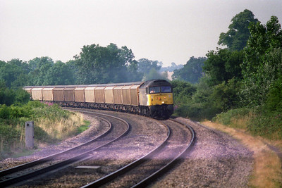 47298 'Pegasus' approaches Heyford with a train of automotive parts from Swindon to Longbridge (22/07/1996)