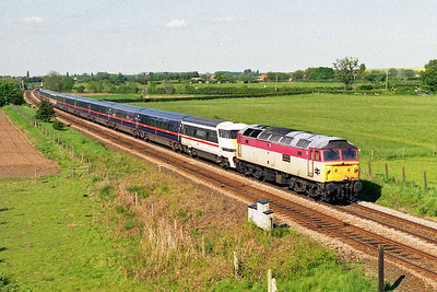 The unique Central Services-liveried 47972 heads the diverted 1E07 1045 Glasgow Central - Kings Cross south of Collingham on the approach to Newark (25/05/1997)