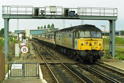 Some 16 hours (and a night in the park following a fruitless search for accommodation) after we'd arrived in Poole, 47314 is seen entering the station with the ECS for the SuO 1E27 1303 to York (17/08/1997)