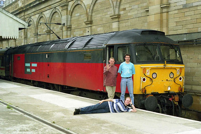 Three of the train's passengers anticipate a tour of local public houses alongside 47782 at Waverley (23/08/1997)