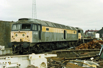 Having made its final journey, 47346 awaits dismantling in Booth's scrapyard at Rotherham. The remains of 47677 are just visible in the background (08/02/1998)