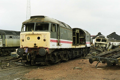 47676 was in the process of being dismantled at Booth's  during my next visit to the yard. To the right are the remains of 47249 (05/04/1998)