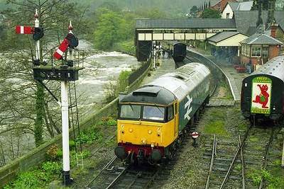 With the River Dee in the background, 47449 runs round at Llangollen after working the 1200 from Carrog (19/04/1998)