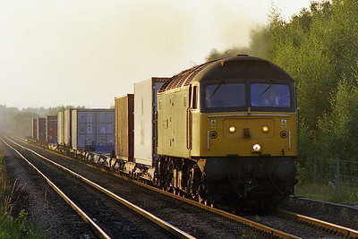 A slightly different view of this location with a telephoto lens: 47114 'Freightlinerbulk' approaches Methley with a lightly-loaded 4L63 2011 Leeds FLT - Tilbury intermodal (29/07/1999)