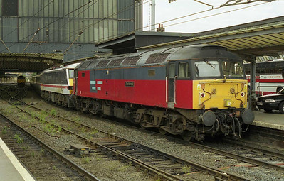 Having been attached to the front of the electric loco, 47777 'Restored' waits to head north from Carlisle over the 'G&SW' with the diverted 1S83 1435 Euston-Glasgow (25/07/1999)