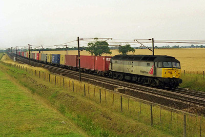 Freightliner's 47323 passes Colton on a rather gloomy afternoon with 4L79 1616 Wilton - Felixstowe intermodal (03/08/1999)