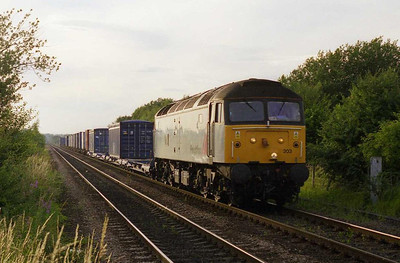 47303 'Freightliner Cleveland' approaches the level crossing at Methley with 4L63 2011 Leeds-Tilbury Freightliner (06/07/1999)