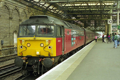 Having arrived with 1Z37 from Stalybridge, 47767 has run round its train and is preparing to depart from Edinburgh Waverley with the empty stock for Craigentinny (31/07/1999)