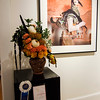 Lori Krinsky poses with her winning floral arrangement of 'Gelede Masquerader' during Fitchburg Art Museum's 19th Annual Art in Bloom on Friday, March 31, 2017. SENTINEL & ENTERPRISE / Ashley Green