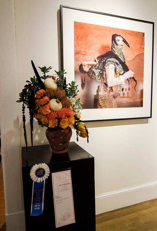 . Lori Krinsky poses with her winning floral arrangement of \'Gelede Masquerader\' during Fitchburg Art Museum\'s 19th Annual Art in Bloom on Friday, March 31, 2017. SENTINEL & ENTERPRISE / Ashley Green