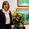 Joan David stands in front of her floral interpretation on display at Fitchburg Art Museum's 19th Annual Art in Bloom on Friday, March 31, 2017. SENTINEL & ENTERPRISE / Ashley Green