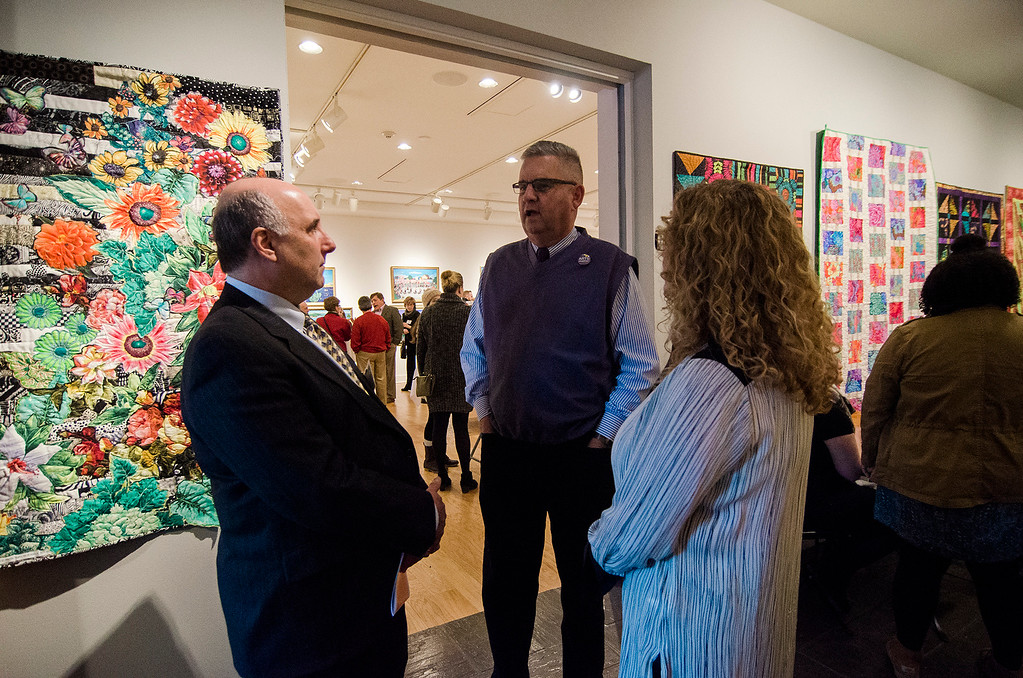 . Fitchburg State University President Richard Lapidus chats with State Representative Stephan Hay during Fitchburg Art Museum\'s 19th Annual Art in Bloom on Friday, March 31, 2017. SENTINEL & ENTERPRISE / Ashley Green