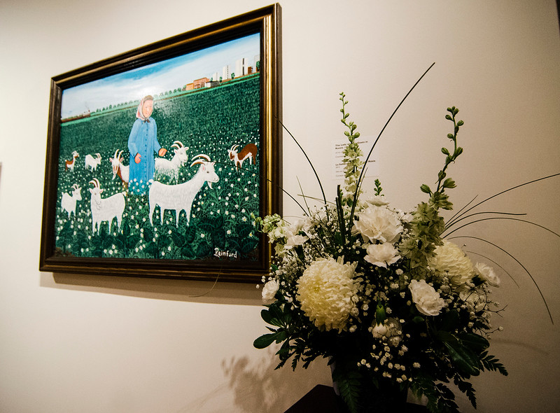 Doris Durran's interpretation of 'The Lady and the Goats' on display at Fitchburg Art Museum's 19th Annual Art in Bloom on Friday, March 31, 2017. SENTINEL & ENTERPRISE / Ashley Green
