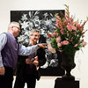State Representative Stephan Hay and Darron Massey take a closer look a floral interpretation of 'Garland with Bird' by Joan Pease and Debbie St. Vrain at  Fitchburg Art Museum's 19th Annual Art in Bloom on Friday, March 31, 2017. SENTINEL & ENTERPRISE / Ashley Green