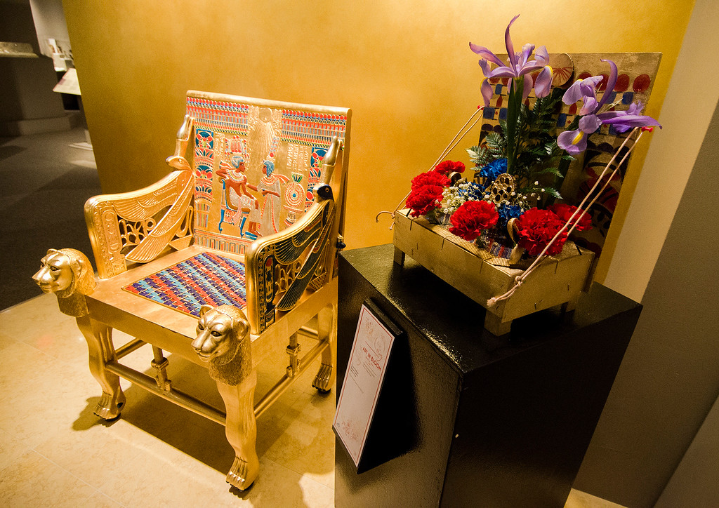 . Carlene DeBlois\'s floral interpretation of \'Egyptian Chair\' on display at Fitchburg Art Museum\'s 19th Annual Art in Bloom on Friday, March 31, 2017. SENTINEL & ENTERPRISE / Ashley Green