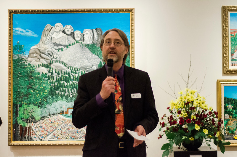 Director Nick Capasso addresses the crowd during Fitchburg Art Museum's 19th Annual Art in Bloom on Friday, March 31, 2017. SENTINEL & ENTERPRISE / Ashley Green