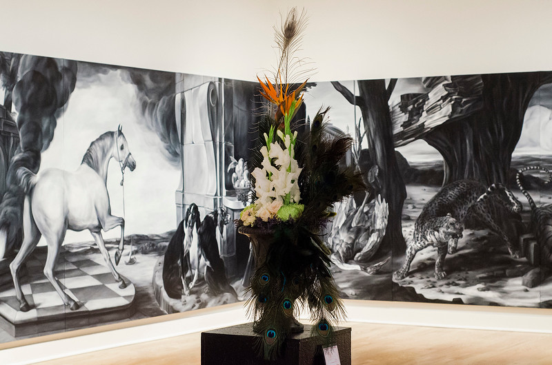 Julie Palioca and Leticia Schiavitti's interpretation of  'In Dubious Battle II' on display at Fitchburg Art Museum's 19th Annual Art in Bloom on Friday, March 31, 2017. SENTINEL & ENTERPRISE / Ashley Green