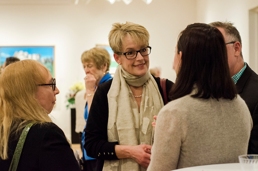 . Christie Stover speaks with guests during Fitchburg Art Museum\'s 19th Annual Art in Bloom on Friday, March 31, 2017. SENTINEL & ENTERPRISE / Ashley Green